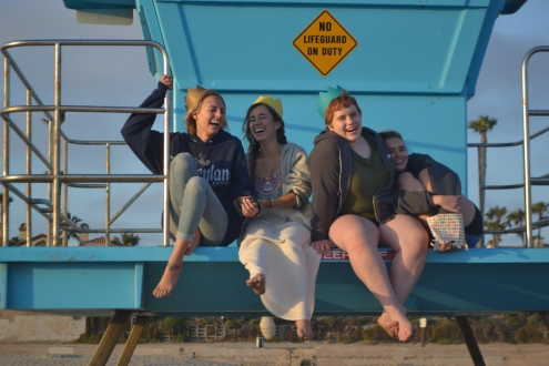 Laughing with my friends as we rebel on the lifeguard tower.