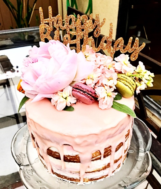 The final product! I admit I did cheat and bought pre-made Macarons from Trader Joe's, but they were delicious just the same! The flowers were also from Trader Joe's and the plastic sign was from Paper Source.